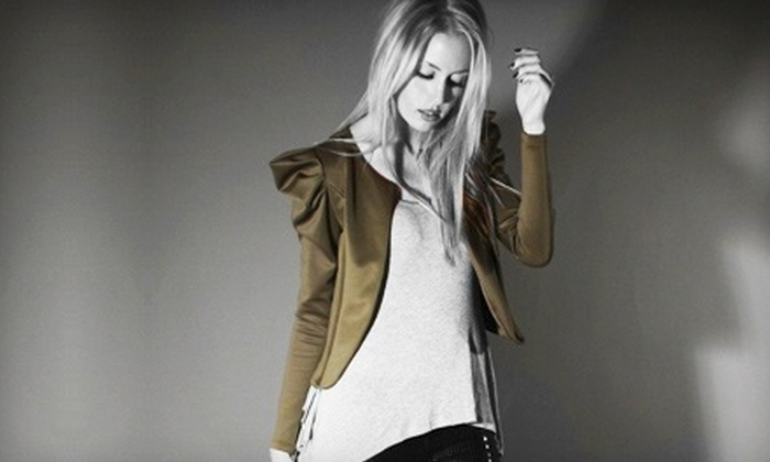 Collage Boutique - Dunbar Springs: $49 for $100 Worth of Women's Clothing, Accessories, and Shoes at Collage Boutique