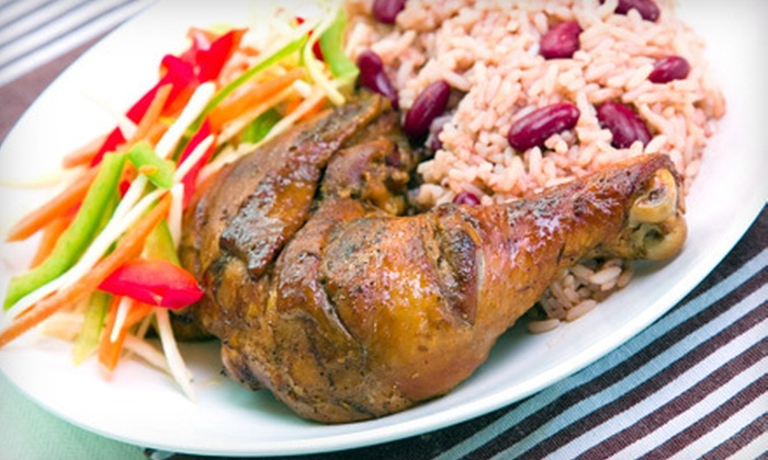 De Real Ting Cafe - Central Civic Core District,Downtown,Urban Core: $15 for $30 Worth of Jamaican Fare at De Real Ting Cafe