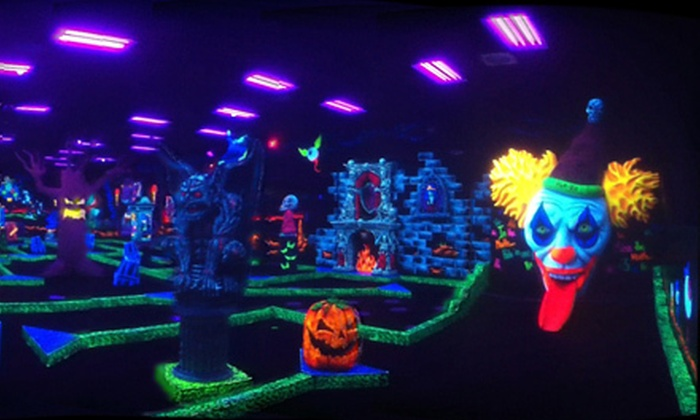 Monster Mini Golf - Multiple Locations: Four or Eight Black-Light Mini-Golf Passes at Monster Mini Golf (Up to 59% Off). Two Locations Available.