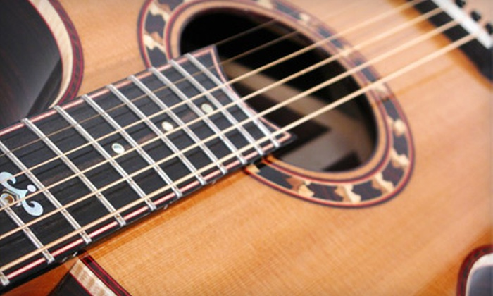 The Guitar Store - Green Lakes: $49 for Four Private Lessons in Guitar, Ukelele, and More at The Guitar Store ($120 Value)
