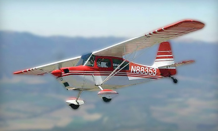 Monarch Sky - Henderson: Aerobatic Flight Adventure with T-Shirt and Drink for One or Two at Monarch Sky