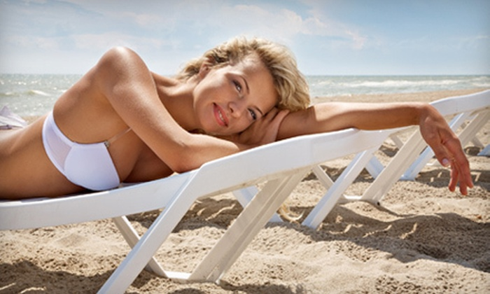 Island Sun Tanning - Multiple Locations: 3 or 6 Spray-Tan Sessions or 10 or 20 UV-Tan Sessions at Island Sun Tanning (Up to 85% Off)