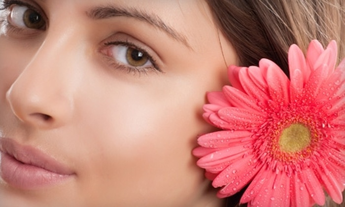Paradise Breeze Tanning and Day Spa - Winnipeg: $59 for a Microdermabrasion Session and Mini Facial at Paradise Breeze Tanning and Day Spa ($138 Value)