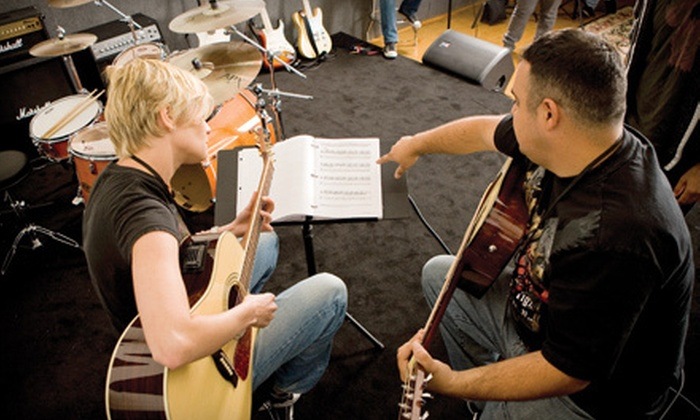 Guitar Center Studios - West Omaha: Four 30-Minute Music Lessons or Four Hours of Rehearsal Space at Guitar Center Studios (Up to Half Off)