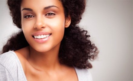 Dental Check-Up, Cleaning, and X-Rays or In-Office Boost Teeth Whitening at Serenity Dental (Up to 89% Off)
