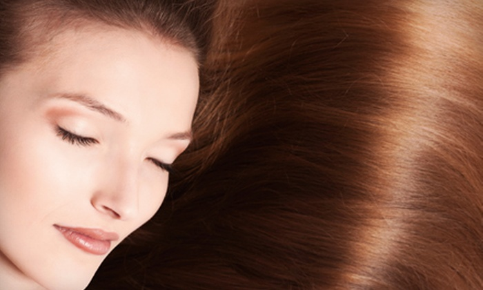 Blues Cut & Color Studio - Marquette: Brazilian Blowout or Hair Extensions at Blues Cut & Color Studio (Up to 60% Off)