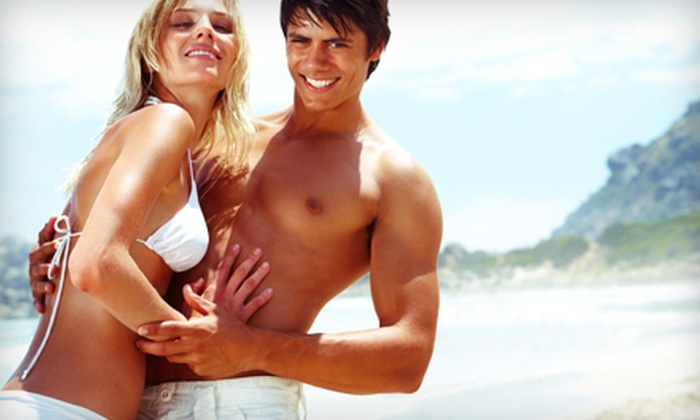 Naked Beach Tanning - Multiple Locations: Two Spray Tans or 10 Tanning-Bed Sessions at Naked Beach Tanning (Half Off)