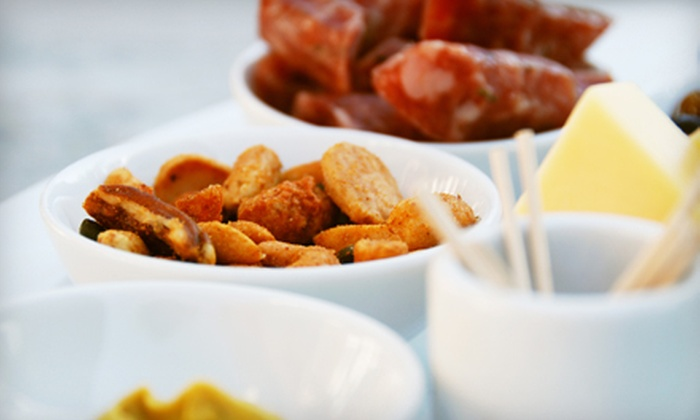 Fred's Food, Fun & Spirits - North Naples: $17 for Tapas, Dessert, and Drinks at Fred's Food, Fun & Spirits ($35 Value)