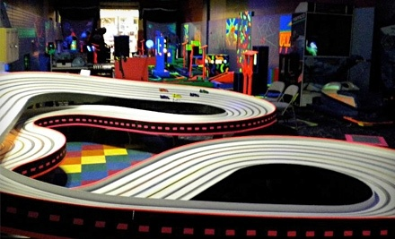 $20 Groupon to Clubhouse Mini Bowl, Golf, and Raceway for Glow-in-the-Dark Mini Golf and Remote-Control-Car Racing - Clubhouse Mini Bowl, Golf, and Raceway in Bozeman