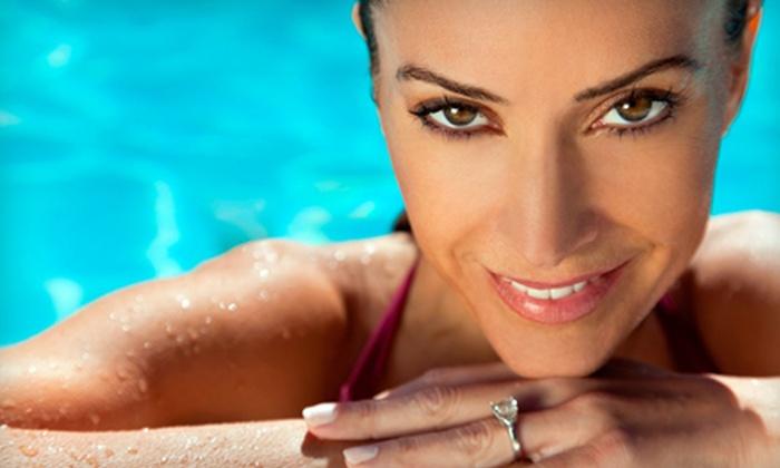 Salon Tropics - Shenandoah: Six-Week Tanning Package or Two Mystic Tan Spray Tans at Salon Tropics (Up to 78% Off)