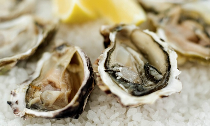 The Island Grille & Raw Bar - Tierra Verde: $19 for Two Dozen Oysters and Two Drinks at The Island Grille & Raw Bar ($36 Value)