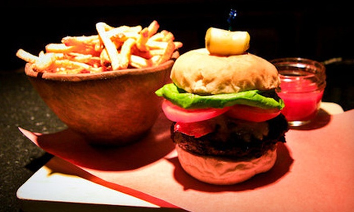 The District - Calgary: Three-Course Gastropub Meal for Two or Four at The District