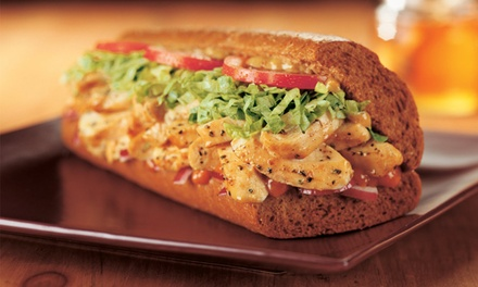 $10.99 for a Meal for Two, Featuring Two Regular Subs, Bags of Chips, and Drinks at Quiznos ($20.63 Value)