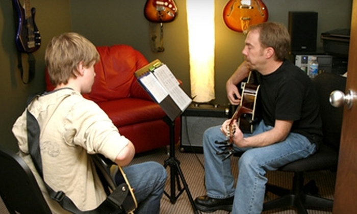 The Guitar Lab - Lorraine Park: $45 for Four Private Electric-, Acoustic-, or Bass-Guitar Lessons at The Guitar Lab ($90 Value)