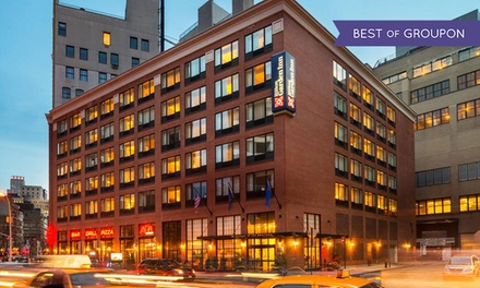 groupon daily deal - Stay at Hilton Garden Inn New York/Tribeca in New York City, with Dates into September