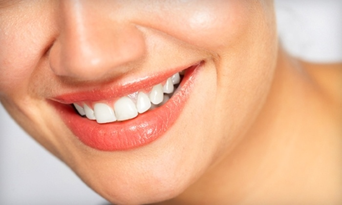Newton Cosmetic Dentistry - Albany: $89 for an Exam, Teeth Cleaning, X-rays, Cancer Screening, and Cosmetic Consultation at Newton Cosmetic Dentistry ($315 Value)
