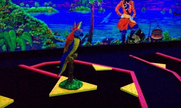 The Golf Beaches - Madeira Beach: $8 for Black-Light Minigolf for Two and Two Drinks at The Golf Beaches in Madeira Beach (Up to $17 Value)