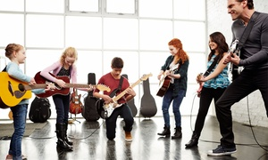 School Of Rock Sutherland: Singing, Guitar, Drum or Bass- 1 ($35) or 4 Lessons + Gift Pack ($129) at School Of Rock Sutherland (Up to $408 Value)