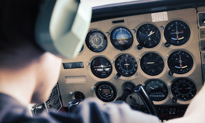 Downtown Aviation - Multiple Locations: $49 for a 90-Minute Flying Lesson with Ground School and Flight Time at Downtown Aviation ($100 Value)