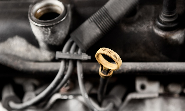 BMD Auto Repair - Landmark - Van Dorn: Regular or Synthetic Oil Change with 36-Point Inspection and Tire Rotation at BMD Auto Repair (Up to 81% Off)