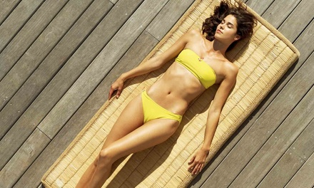 Airbrush Spray Tan with Optional Brazilian Wax at Modish Studios Salon (Up to 51% Off)