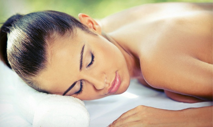 The Ultimate Tan & Med Spa - Multiple Locations: 90-Minute Therapeutic Massage, or 60-Minute Massage or Microdermabrasion at The Ultimate Tan & Med Spa (Up to 69% Off)