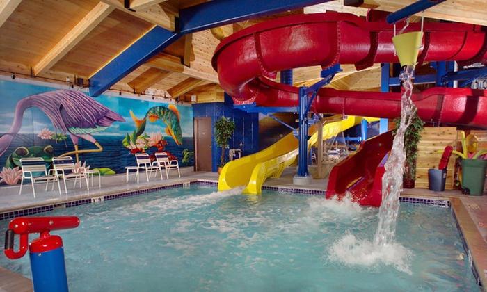 American Splashland - Ashland: One-Night Stay with Option for Snacks and Game Tokens at AmericInn and Splashland in Ashland, WI