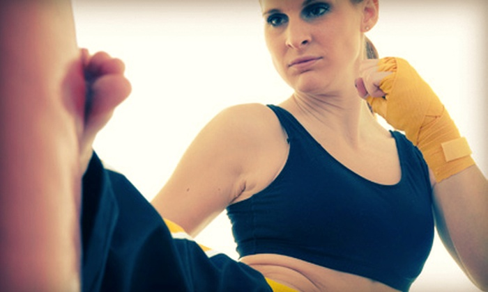 CKO Kickboxing - Shoreline: $29.99 for Three Classes with Gloves at CKO Kickboxing ($85 Value)