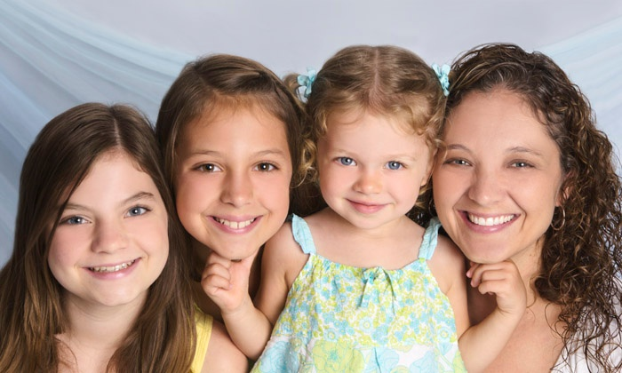 JCPenney Portraits - Multiple Locations: Portrait Packages with Three-Image CD and Prints or Gallery-Wrap at JCPenney Portraits (Up to 88% Off)