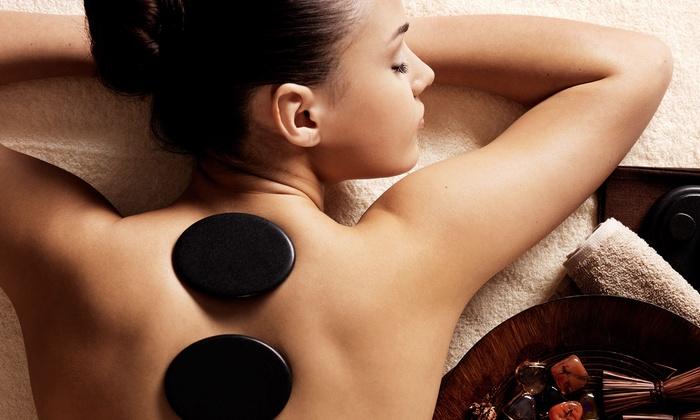 Anew Day Spa - Multiple Locations: 75-Minute Hot-Stone Massage with Chocolate and Fresh Fruit for One or Two at Anew Day Spa (Up to 57% Off)