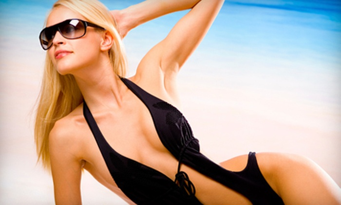 Amazing Tans - Multiple Locations: One Month of Unlimited Tanning, or Three or Six Full-Body Spray Tans at Amazing Tans (Up to 67% Off)