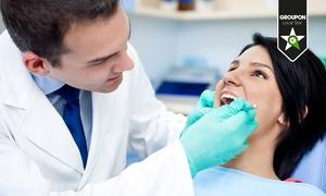 Dr. Giuseppe Ruggia: Visita odontoiatrica con igiene orale completa, otturazione estetica e sbiancamento LED in zona Prati