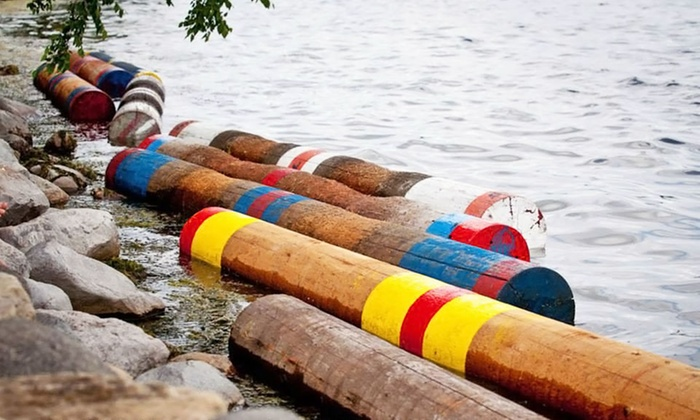 Madison Log Rolling - Wingra Canoe and Sailing Center: 6 or 10 Beginner Log-Rolling Classes or Adult Lager Loggers Package from Madison Log Rolling (Up to 67% Off)