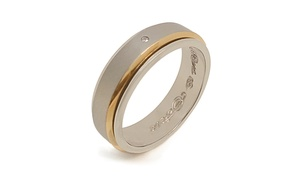 Capri Jewelers: $21 for a Two-Tone Titanium and Gold Diamond Accent Band from Capri Jewelers ($100 Value)