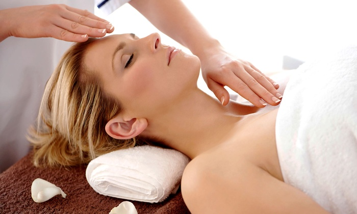 Light Rays - Rockford: One or Two 60-Minute Craniosacral Massages with Reiki and an Essential Oil Treatment at Light Rays (51% Off)