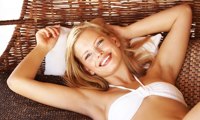 ULTRA TAN - Multiple Locations: 4, 8, or 12 Red-Light Therapy Sessions at Ultra Tan (Up to 61% Off)