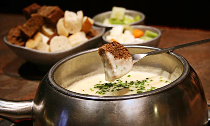 The Melting Pot - Dayton: $34 for Three-Course Fondue Meal for Two at The Melting Pot (Up to a $67.70 Value)