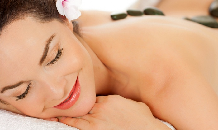 Peace Through Massage - North Central: $45 for Massage with Hot Stones, Aromatherapy, and Mask at Peace Through Massage (Up to $97 Value)