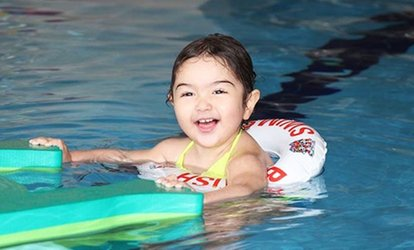<strong>Swimming</strong> Lessons for One or Two Children with Registration and Swim Cap at British Swim School (53% Off)