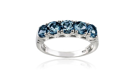 1.5 CTTW Blue Topaz Half Eternity Ring in Sterling Silver