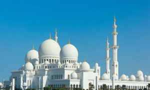 Baisan Travel LLC: Abu Dhabi City Tour with Theme Park Entry for One, Two or Four with Baisan Travel LLC