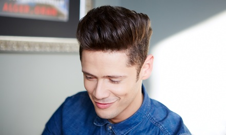 Haircut and Highlights or Blowout or Men's Haircut and Optional Grey Coverage at Hair Carrigan (Up to 57% Off)
