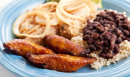 Caribbean Meal for Two or Four with Entrees and Dessert at Sunset Paradise (Up to 50% Off)