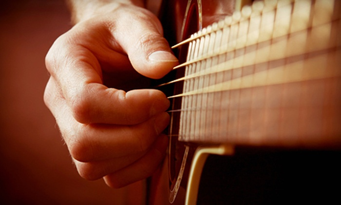 Mercury Guitar Studio - Grand Rapids: Four or Eight 30-Minute Guitar Lessons at Mercury Guitar Studio (Up to 53% Off)