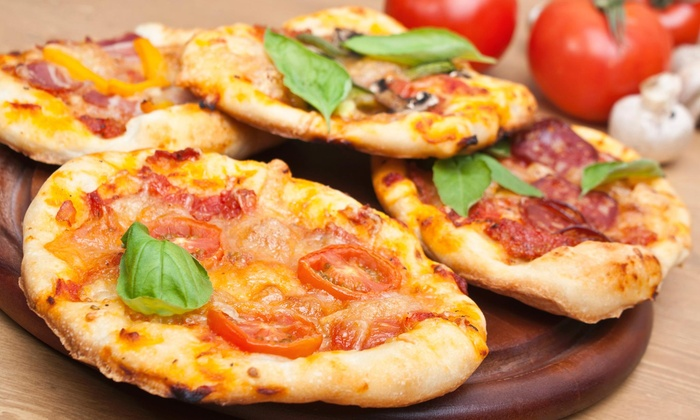 Justinos Pizza - Richmond Town: $1 Buys You a Coupon for Free 20oz Soda With Purchase Of Any 2 Speciality Slices at Justinos Pizza