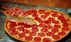 Bell's Greek Pizza - East Lansing: $7 for $14 Worth of Greek Fare and Pizza at Bell's Greek Pizza