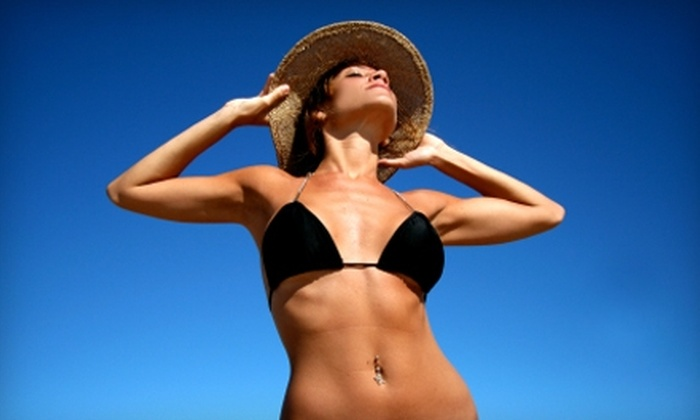 X-Treme Tanning - Clinton: $45 for Three Three-Step Spray-Tan Sessions at X-Treme Tanning ($105 Value)