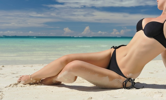 Miles Salon and Spray Tanning - Lexington: $18 for Two Spray Tans at Miles Salon and Spray Tanning (Up to $36 Value)