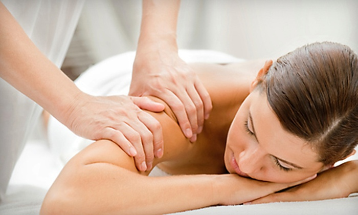 Peace Through Massage - North Central: $49 for Spa Package with Massage, Foot Scrub, Foot Mask, Aromatherapy, and Hot Stones at Peace Through Massage (Up to $104 Value)