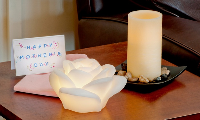 Himalayan Glow Flameless Candles: $12.99 for a Himalayan Glow Flameless LED Pillar or Rose Candles with Remotes (Up to $49.99 List Price). Free Returns.